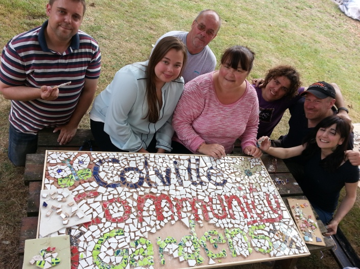 Residents having fun designing a mosaic for the Communal Garden